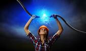 Image of woman holding electricity cable above head