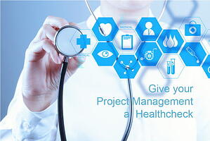 Medicine doctor hand working with modern computer interface as concept_give your project management a Healthcheck_500