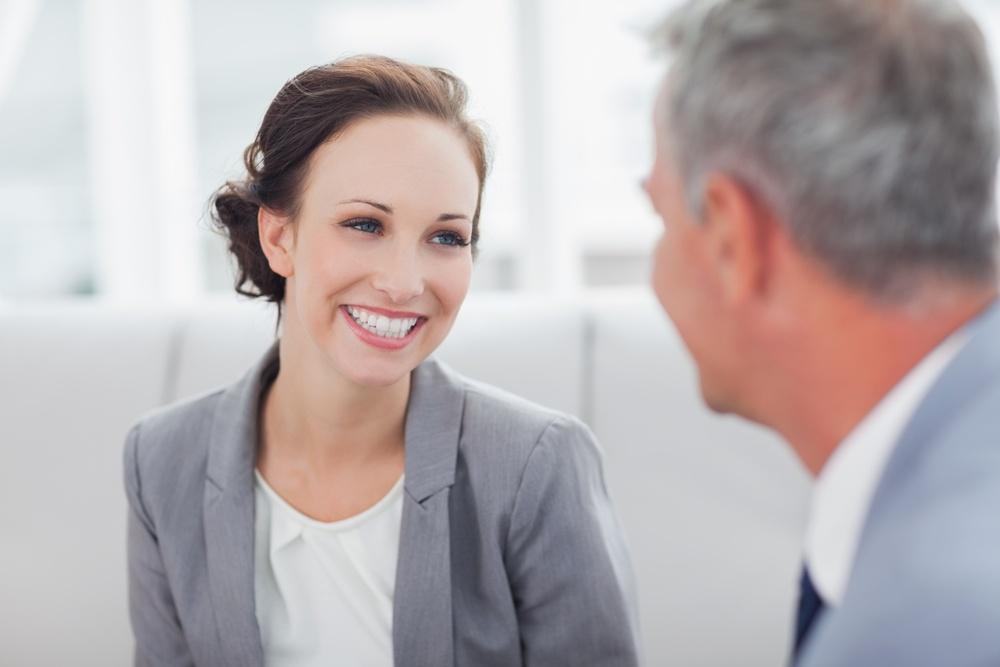 Cheerful businesswoman listening to feedback