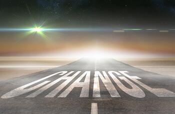 The word change against road leading out to the horizon